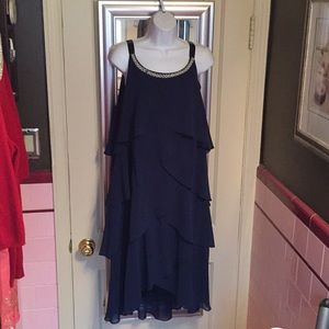 Navy blue tiered dress with pearl collar